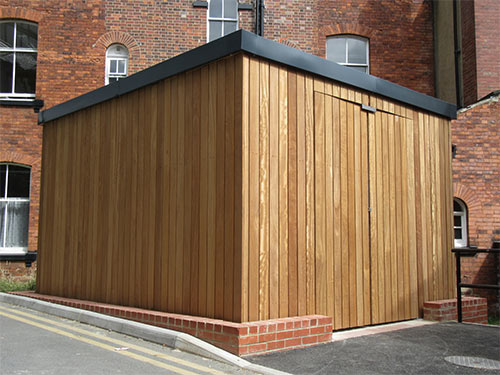 Timber clad shelter by Bollard Street, UK Street Furniture Specialists